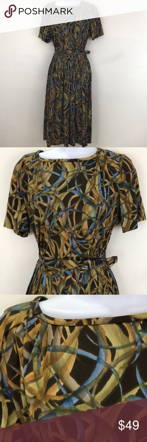 """Stunning vintage dress. Circa 1950's/60's. Wonderful print and colors, Browns - blues and greens. I'm sure this is acetate. Farted around collar, short sleeves, belt, full pleated skirt. No tags. One flaw shown in pic is a seam that needs to be stitched. Bust 42, waist 30 and length 41"""". The belt has the maker- """"Burlington brand"""" but no size. First hole on belt is 29"""", 30"""", 31"""",32"""" and 33"""". There isn't any give in fabric Burlington Dresses Midi"""