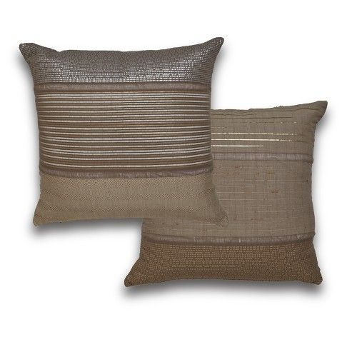 Add a little sheen and sparkle with these oversize throw pillows featuring delicately ribbon weaving. Handmade in Morocco.