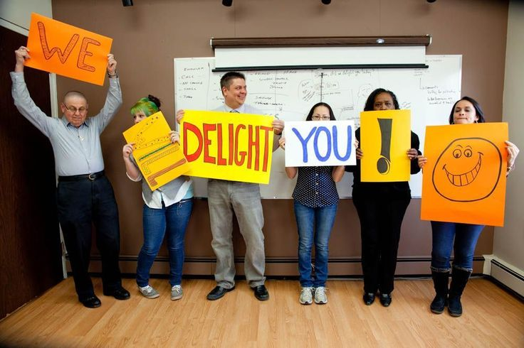 delight, bedelighted, LMT, Last Minute training, group photo, workplace, happy, funny, job, employees, fun, signs
