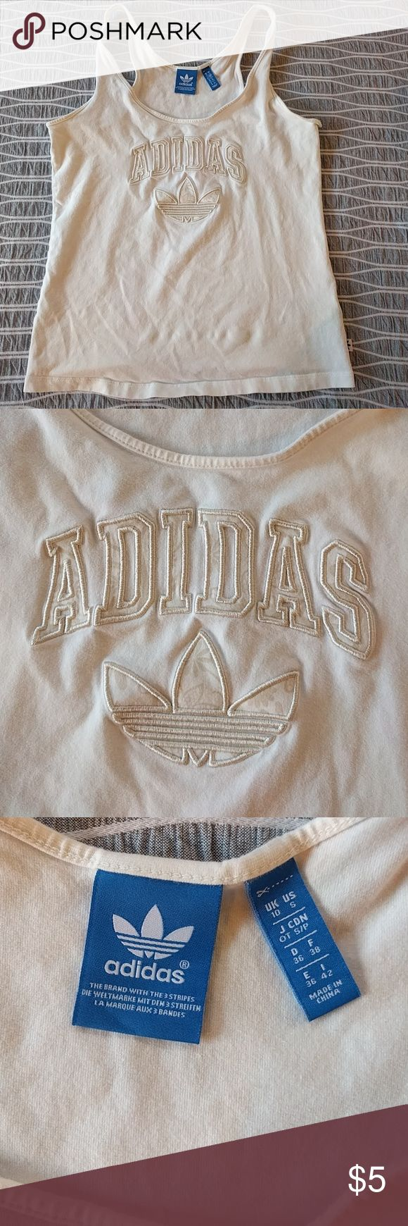 Adidas muscle tank Light cream colored adidas tank worn/washed twice. No stains and in excellent condition (just washing). Adidas Tops Tank Tops