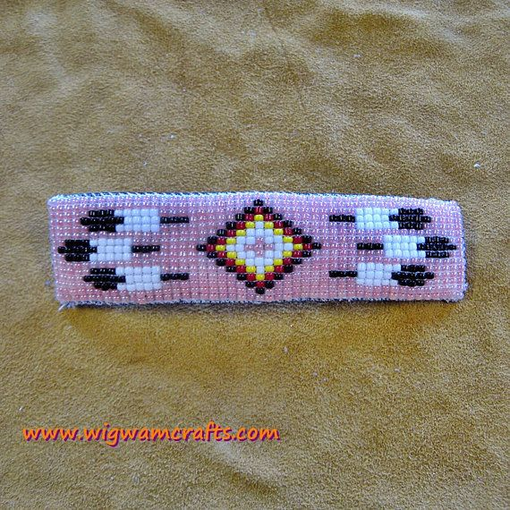 NATIVE AMERICAN INSPIRED BEADED LOOM WORK HAIR BARRETTE  Feathers and a center diamond pattern are the accents for this shimmery pink hair $28.00