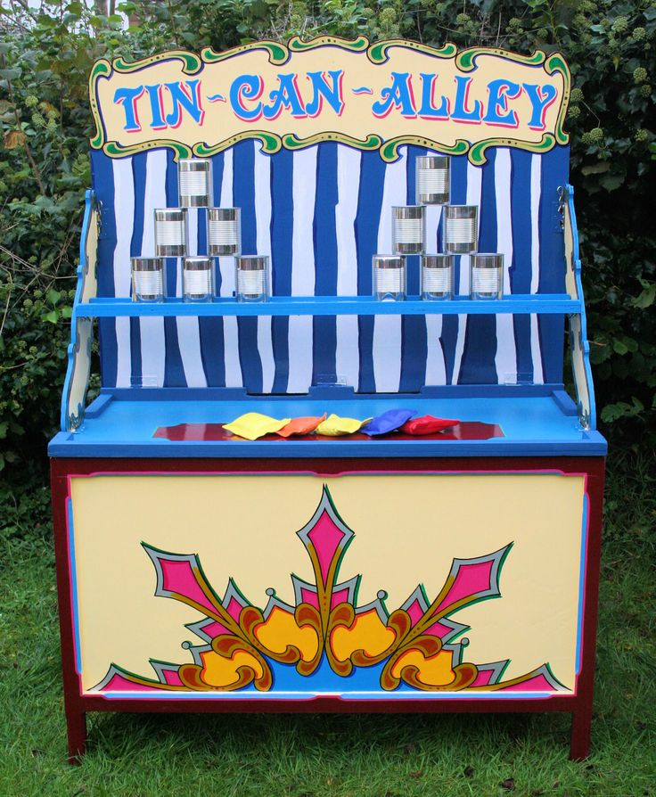 Classic Village Fete game - how many cans can you knock off the shelf?