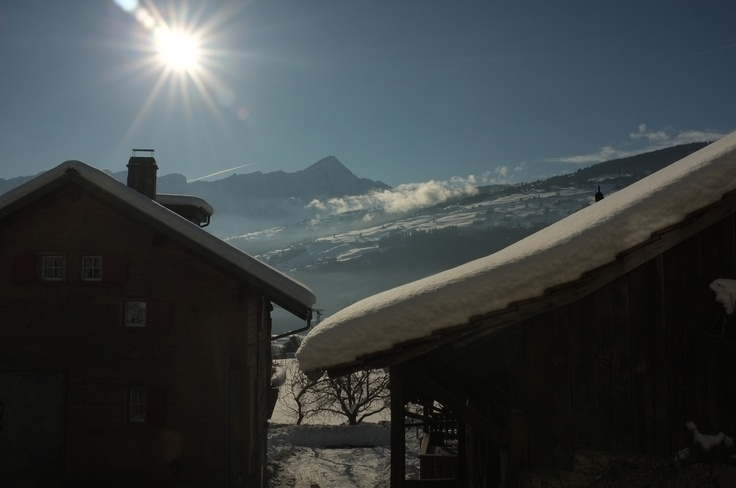 the view when you are standing at the balcon: piz beverin, heinzenberg skiing area and sun, sun, sun