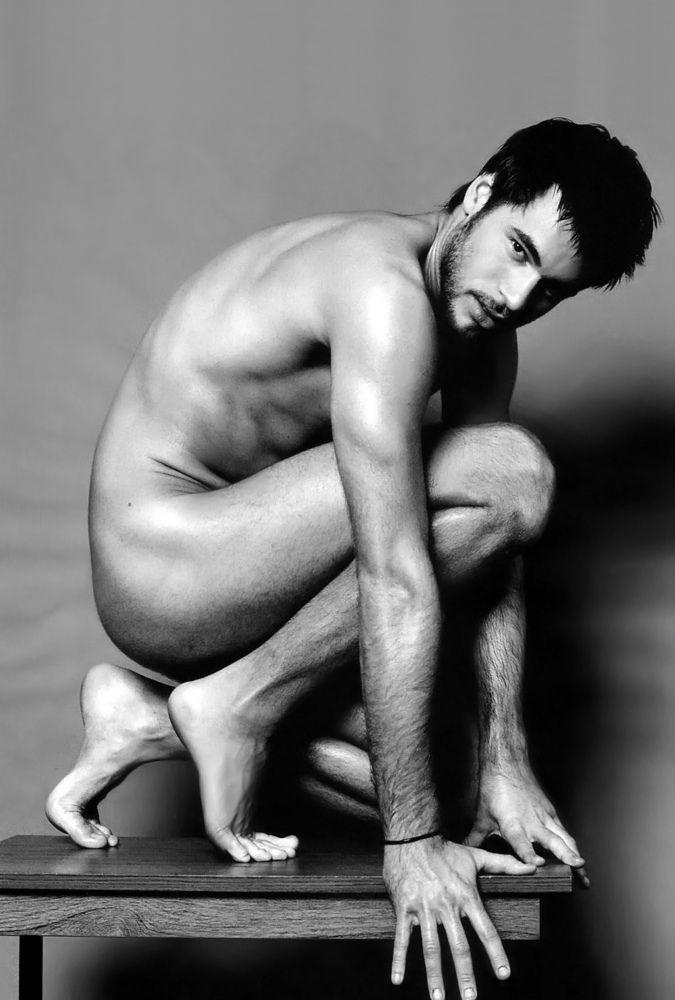 Nude male art model poses something