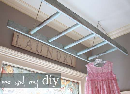 Laundry room storage - hang an old ladder overhead for easy drying rack