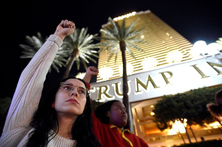 Demonstrators chant in protest against the election of Republican Donald Trump as President of the United States, at the Trump International Hotel & Tower in Las Vegas, Nevada, U.S. November12, 2016. REUTERS/David Becker TPX IMAGES OF THE DAY - RTX2TEN1