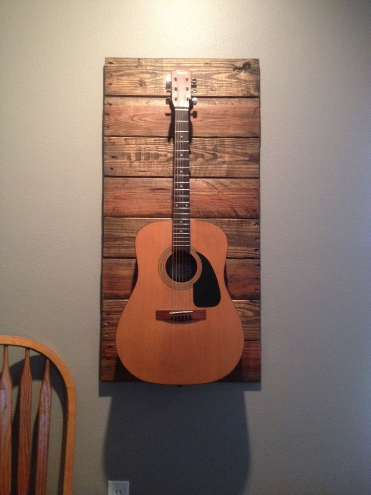 Wood plank guitar holder! I love this! I'm so doing it for AJ's guitars!!