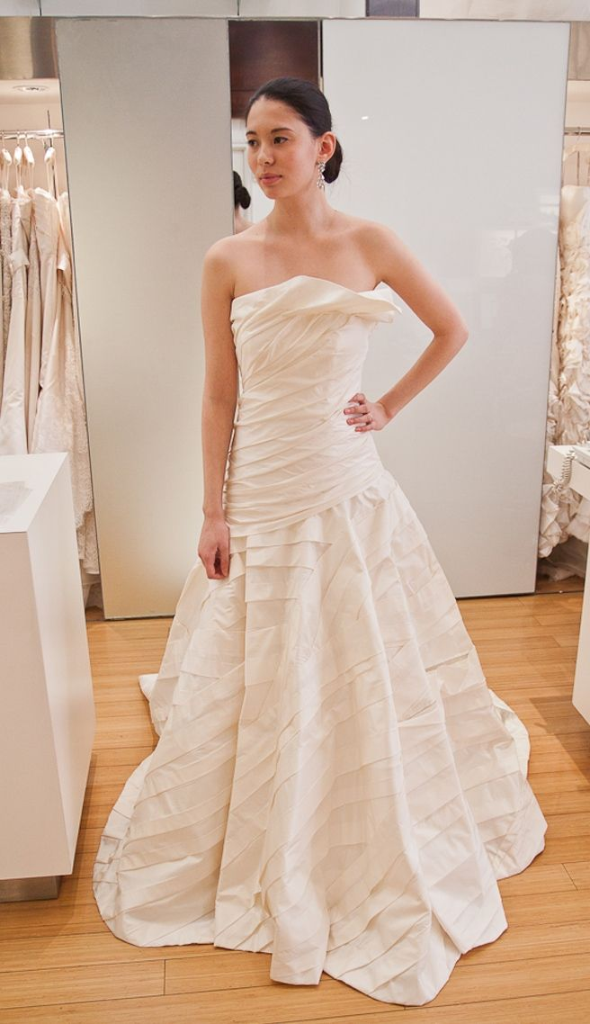 Manuel Mota    Silk taffeta, architeturally draped a-line skirt, fitted hip. Draping throughout the whole gown.  Color: Ivory  Size: 10  Original Price: $3,960  Sale Price: $1,500