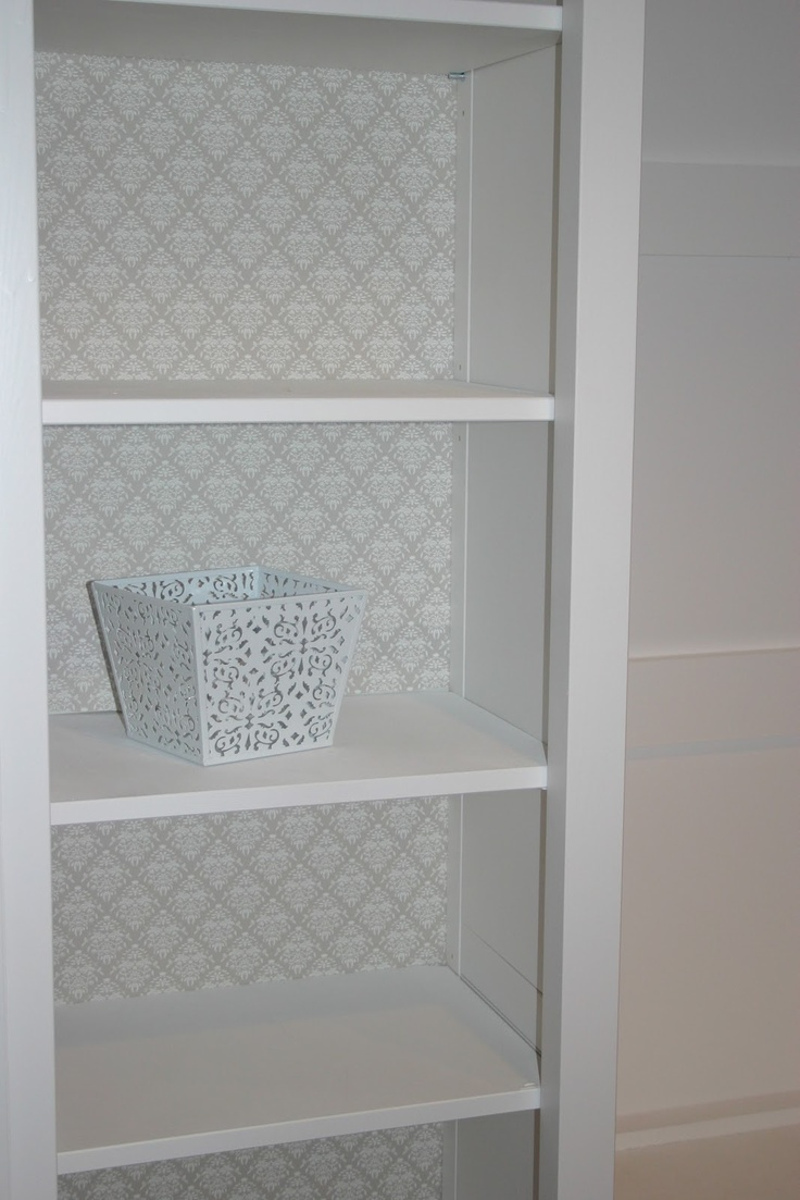 Shelf liner instead of paint for the inside of the recessed shelving.