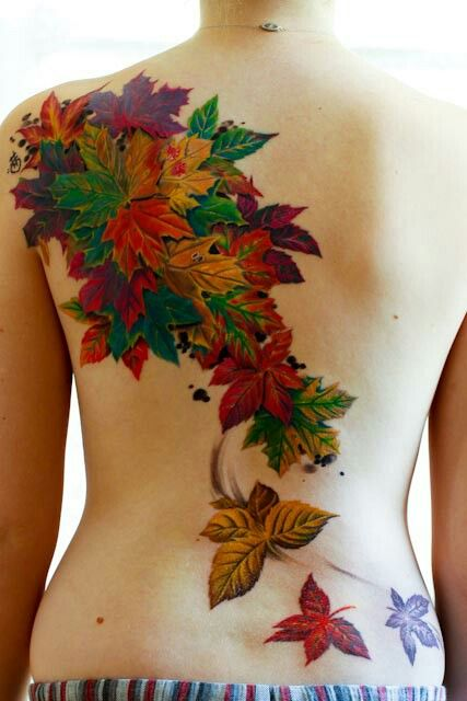 "My favorite is the falling leaves back piece.  I'm only fifteen and a half, but I an inquiring around my local tattoo shops to see if they will apprentice me. Soo exciting! All my friends have me do henna tattoos on them before every school dance, and for winter ball I charged a few strangers for it, too. I enjoy the simple secret message tattoos like the 'love' one, and if I get my tattoo license when I'm 18 I'm thinking about gettng ""volare parum papilio"" behind my shoulder. It means ""fly…"