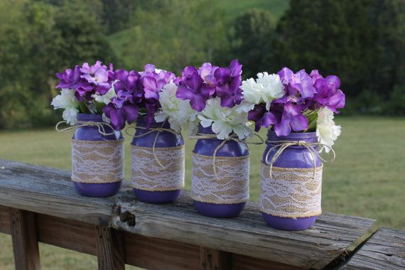 If youre looking for country with a touch of elegance then these are for you! Grape purple painted mason jars wrapped in lace burlap and adorned with a twine bow. Each pint size jar is 5 and 1/4 tall, making them the perfect height for table centerpieces at your reception. They also work beautifully for baby showers or just adding a splash of color around your home. The painted jars (along with the burlap and twine) can be purchased alone (see pictures above) the artificial flowers shown can…