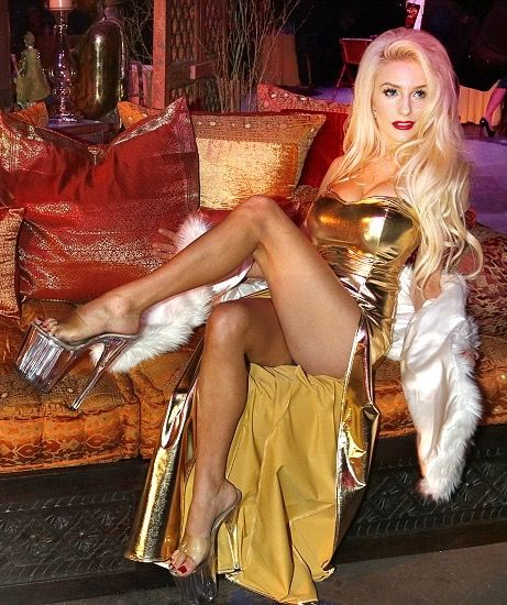 Courtney Stodden in a gold dress and white fur stole at 'The MuayThai Championship' in Playa Vista, Los Angeles (December 1, 2012)