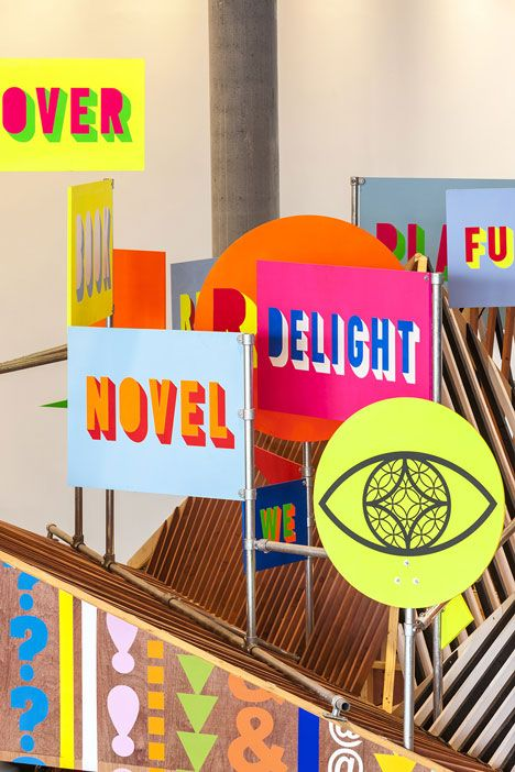 Neon words and symbols embellish the exterior of this temporary wooden pavilion inside the new Library of Birmingham