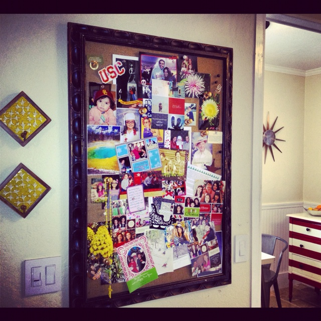 Old frame repurposed with burlap as bulletin board near the entry way