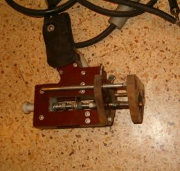 Stud Welder Gun - Homemade stud welder gun constructed from wood, bar stock, spring, cables, spring, and capacitors.