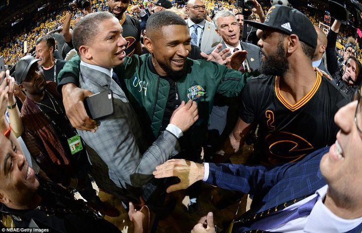 Music artist Usher (centre) was at Oracle Arena to celebrate alongside Cleveland Cavaliers head coach Tyronn Lue (left) and Irving (right)