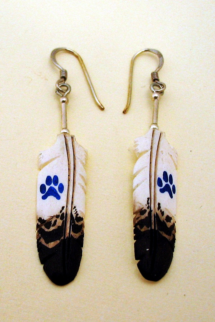 Buffalo bone feather earrings featuring a bobcat paw for Native american feather jewelry