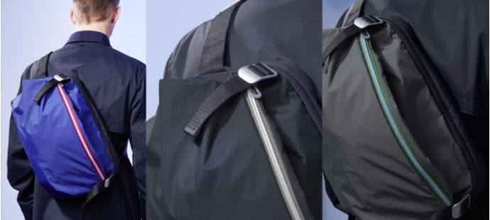 """Inspired by ancient Japanese armour, the Riss messenger bag has been given a twenty-first century update in lightweight blue, black and grey nylons. Designed to be worn close to the body, either over the shoulder or across the back, it accommodates devices up to 13"""" in its integral padded computer pocket."""