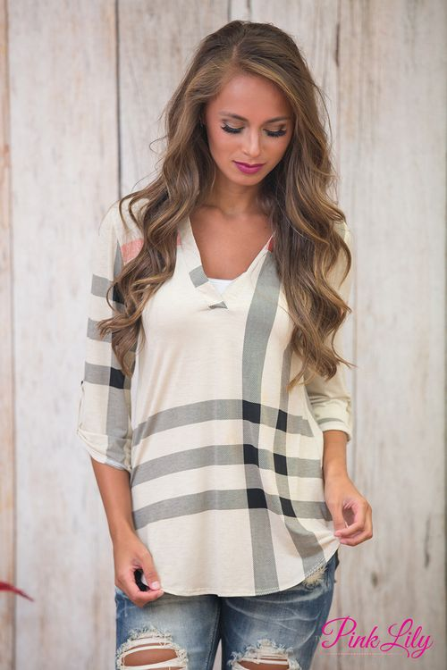 If you'd been looking for a unique twist on the classic plaid tunic, we've got a gorgeous tunic for you right here! Featuring a plaid print in oatmeal, red, and black, this stunning combination is sure to stand out!