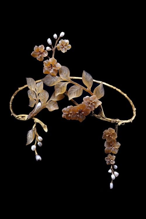 "Paul Liénard, one-of-a-kind Art Nouveau tiara, c1905, with textured gold branches, carved horn leaves and apple blossoms, collet-set diamond pistils, baroque pearl buds, and suspending two detachable clusters of flowers and leaves. Known as the ""Forget Me Nots"" tiara. Photo Qatar Museum via Albion Art."