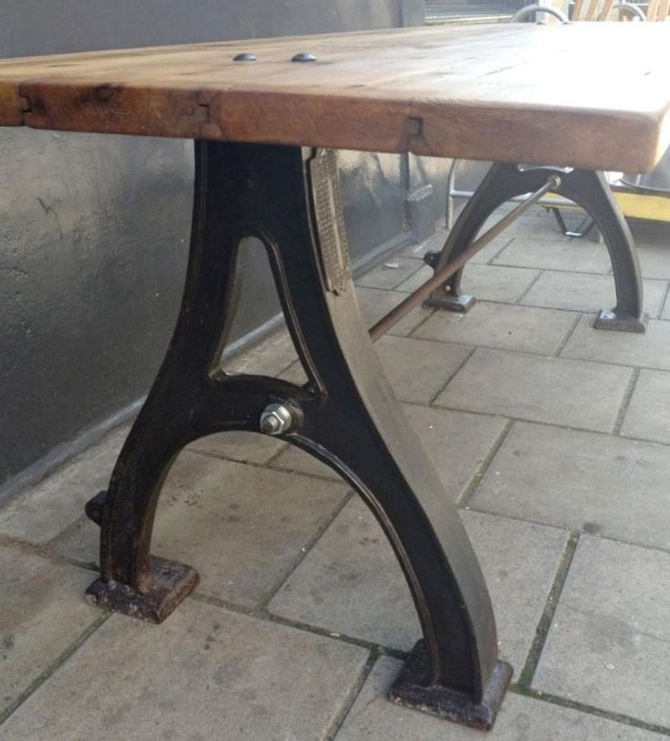 This large dining table was up-cycled from antique pitch pine boards salvaged from a former West London public swimming pool built in 1904, with vintage industrial cast iron legs which would have originally been made to support factory machinery. This impressive table has an excellent finish and has been waxed. This is a wonderful and unique table with a vintage industrial feel!