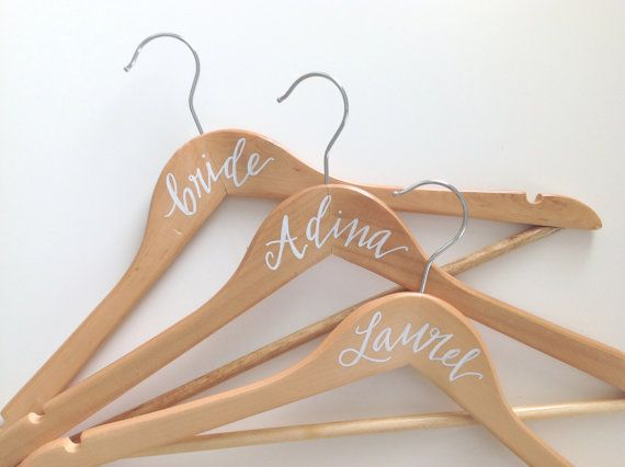 This listing is for ONE (1) Personalized Calligraphy Hanger. The hanger is NATURAL colour and made of wood. The lettering is done by hand with