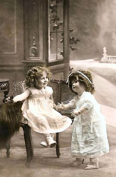 vintage photo little girl with doll ~ Doll is bigger than little girl.