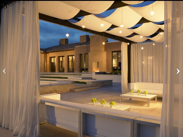 Outdoor Patio. Love the drapes enclosing the area and drapes and lights hanging from pergola. So cozy and romantic.
