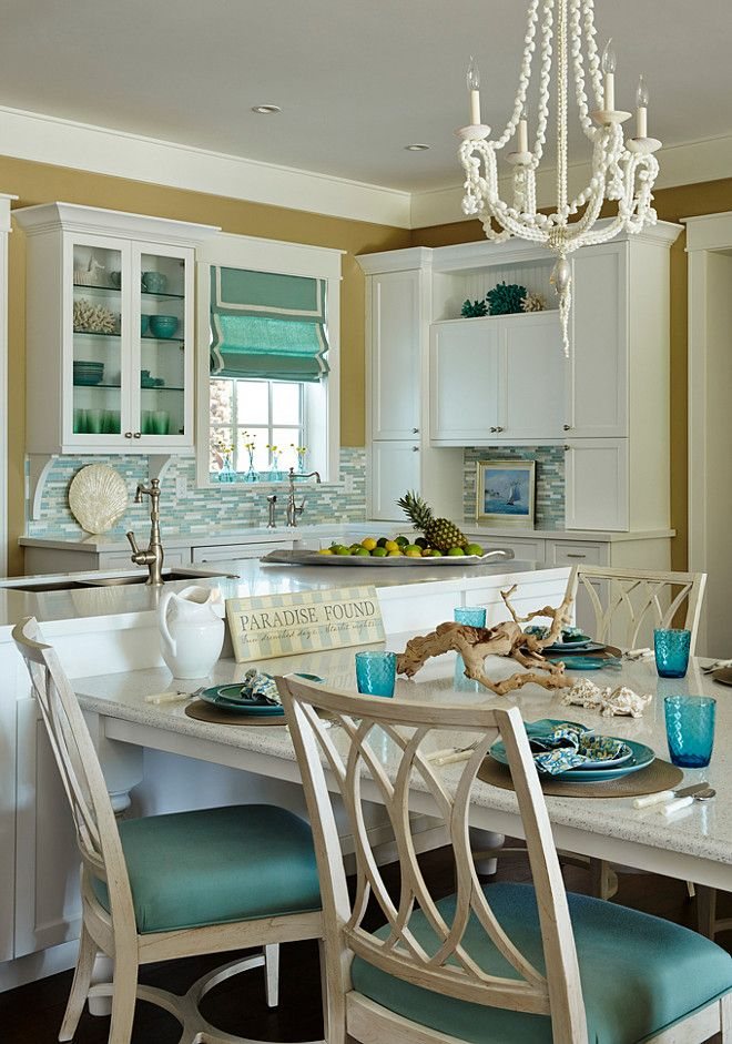 Coastal white and turquoise kitchen. T-shaped kitchen island with table. #Kitchen #KItchenIsland JMA Interior Design.
