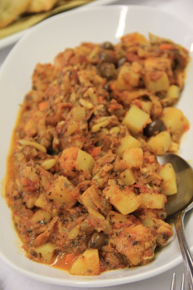 Stoccafisso  accomodato (stewed stockfish) allowed for  another specialty that is prepared with onions,  garlic, parsley, tomatoes, potatoes, pine nuts and  Taggiasche olives.