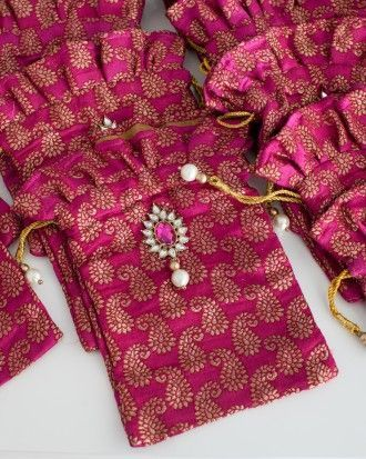 From the sangeet: Pink pouches were set out for guests to put their bangles and bindis in to take home.
