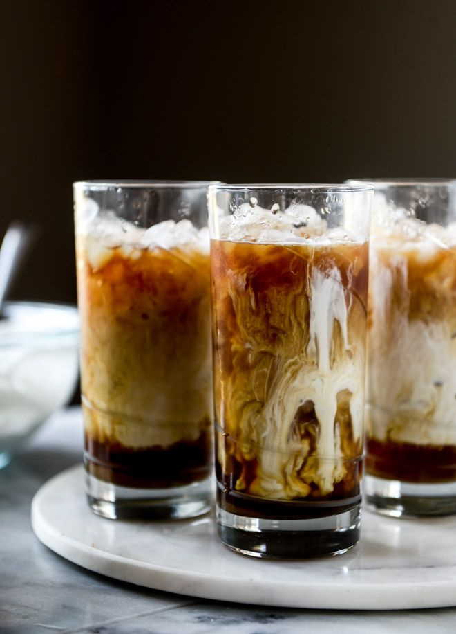 Iced Whiskey Coffees with Whiskey Syrup and Whipped Cream.