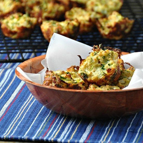 Summer Zucchini Bites: Im always looking for great, healthy snacks for our family. This is a great way to get the kiddos to eat their vegetables! I used slightly less onion in our muffins since they were geared to a 2-year-old. These are very similar to a potato pancake, except you are using zucchini instead of potato. — Maeghan of The Way to His Heart Get Maeghans Summer Zucchini Bites recipe