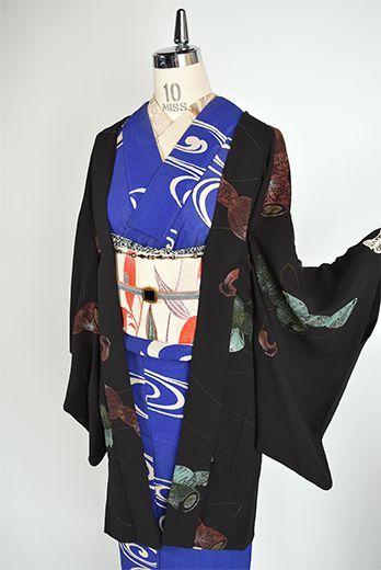 蒔絵美しい鼓胴文様が典雅に染め出された大正浪漫・昭和レトロな詩情ただよう単の長羽織です。