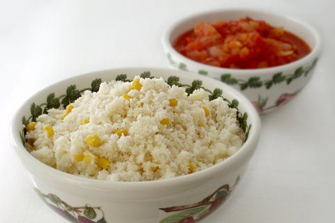 PAP – a porridge made from MAIZE (corn) MEAL – is a staple food of southern Africa. This crumbly version (maize mixed with very little water) is usually combined with a tomato-and-onion sauce, such as sheba sauce or chakalaka sauce, and served as a side dish for barbecued meat or boerewors. Lexi Mills says it's one of the top 10 foods that she & other South Africans in London crave: http://thedisplacednation.com/2012/05/08/when-in-london-hey-ag-no-man-10-foods-i-still-miss-from-my-homeland/