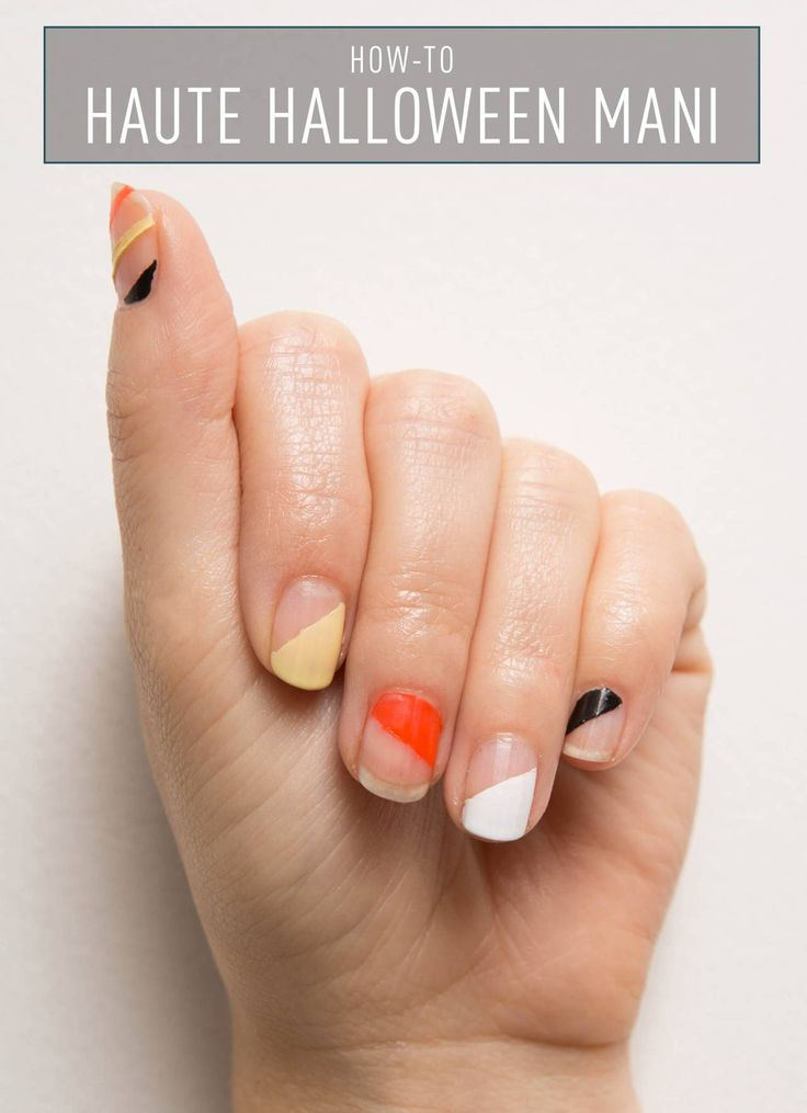 HAUTE HALLOWEEN MANI: Here's the grown-up way to wear Halloween colors this October. Follow this easy tutorial from Cosmo's beauty editor Carly Cardellino to create this chic look. You'll need a basecoat, topcoat, festive nail polish colors, and transparent tape. See the full instructions here.