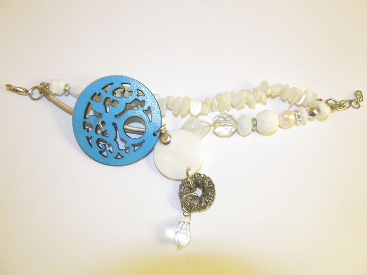 Handmade laser cut leather beaded bracelet (1 pc)  Made with turquoise leather filigree, mother of pearl, glass beads, metal wire part, white coral, white freshwater pearl, leather cord and metal with strass.