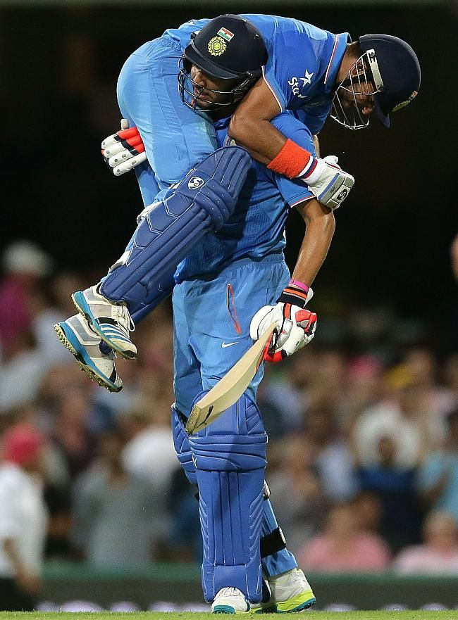 Suresh Raina and Yuvraj Singh celebrate after the win