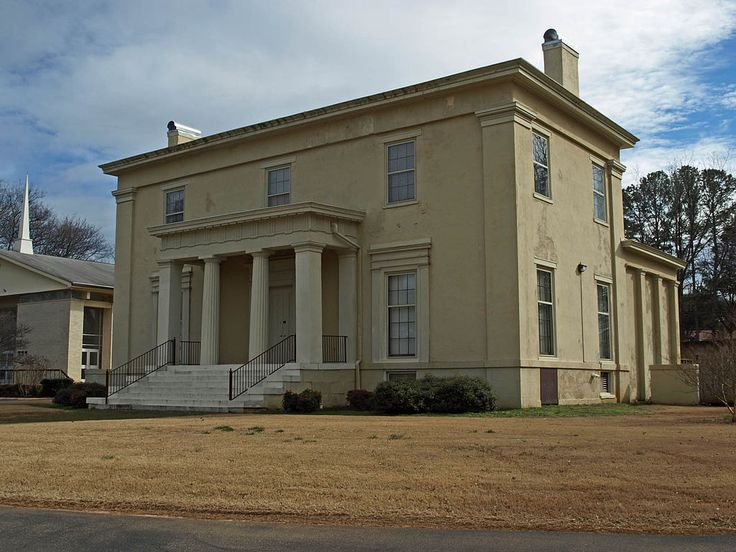Oak Place  in Huntsville, Alabama, was built by renown Huntsville architect George Steele in 1840. The house has a low hipped roof, & is three stories, although it appears as two stories with a basement due to its unusual interior layout. The façade has three steps leading to a one-story, flat-roofed portico supported by two square Doric columns on the corners and two fluted Doric columns in the middle. The entablature is the most decorated part of the house