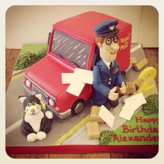 Postman Pat cake, featuring letters, his bright red van and his black and white cat, Jess.