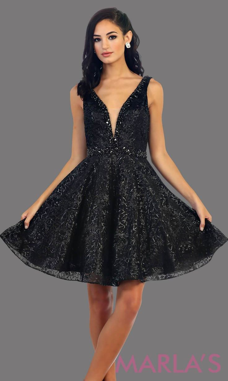 eac83a3eab 7438-Short black dress with deep V neck and back. This is a perfect grade 8  grad dress