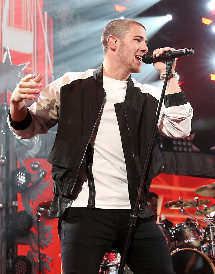 Singer Nick Jonas performs onstage during 103.5 KISS FM's Jingle Ball 2015 presented by Capital One at Allstate Arena on December 16, 2015 in Chicago, Ill.