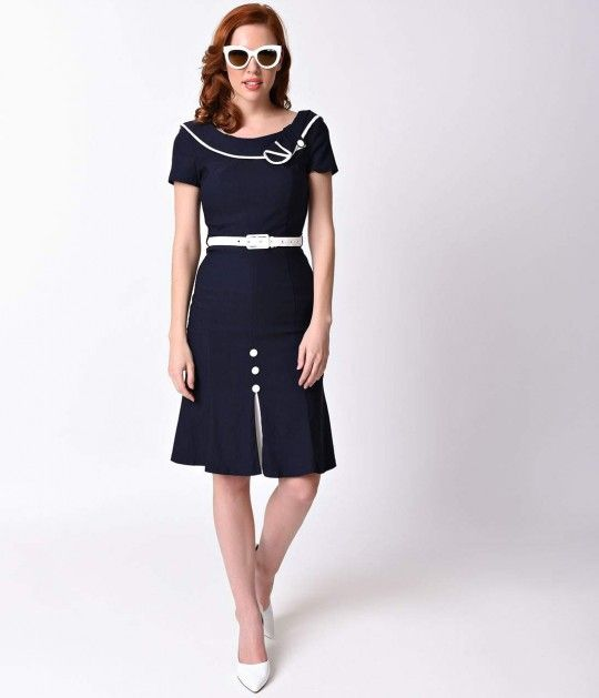 Does Luanne put your stomach into knots, dames? This divine retro sailor dress from Voodoo Vixen is superbly stretchy and cast in a 1940s nautical design. A cap sleeved bodice has elegant white piping and a notched wrap around collar, boat neck and perfec