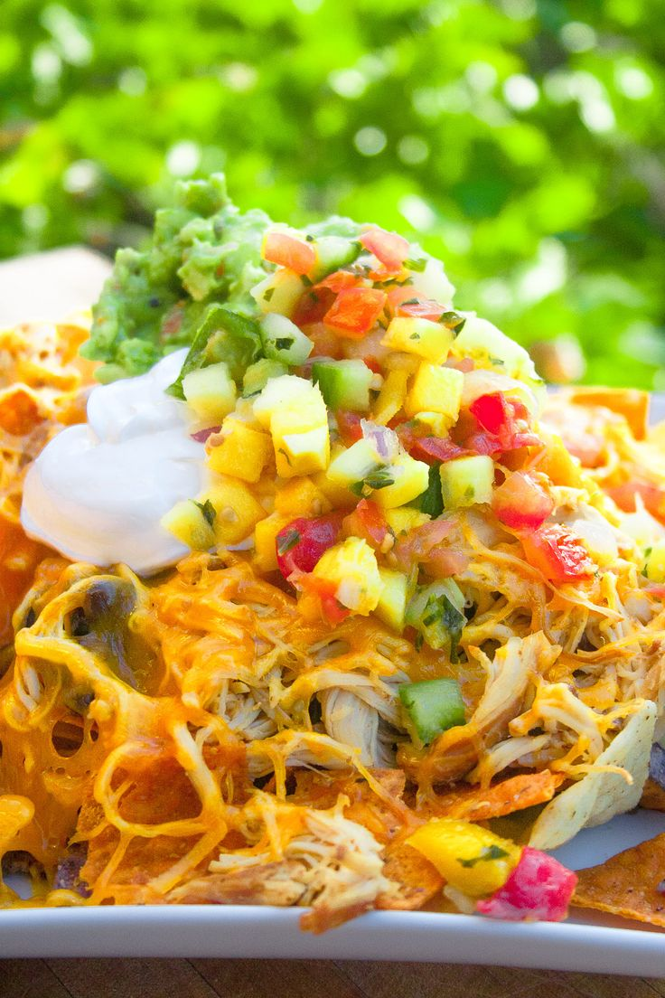 Slow Cooked Shredded Chicken Nachos. Awesome treat for the family!