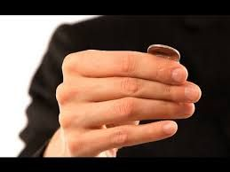 Slight of hand with a coin. PIN IT! http://www.magictricksreviewed.com/learn-easy-magic-tricks-with-coins/ #magic coin tricks #tricks with coins #magic tricks #magic #coin tricks #magician #learn magic #beginners magic