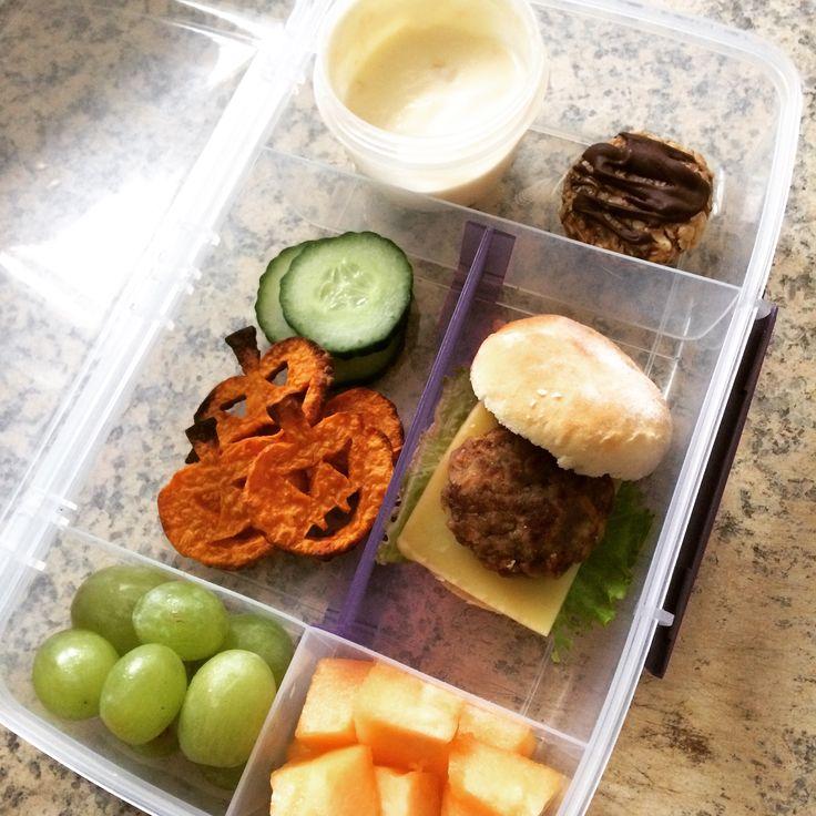 Lunch box idea : Peach yoghurt  No bake cookie  Sliced cucumber  Kumara jack o lantern chips  Green grapes  Rock melon  Homemade Mini burger