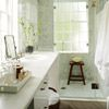 Floor to ceiling glass doors, mosaic shower, plain white vanity
