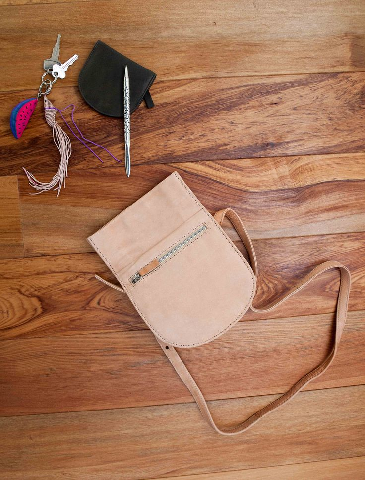 Trade Aid - fair trade - gorgeous nude leather bag - shrimp key ring - small black wallet