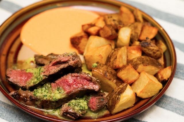 chimichurri skirt steak with patatas bravas and romesco aioli # ...
