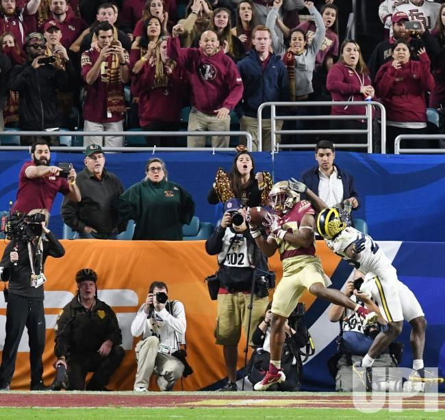 Florida State Seminoles WR Nyqwan Murray scores in the fourth quarter against the Michigan Wolverines of the 2016 Capital One Orange Bowl…